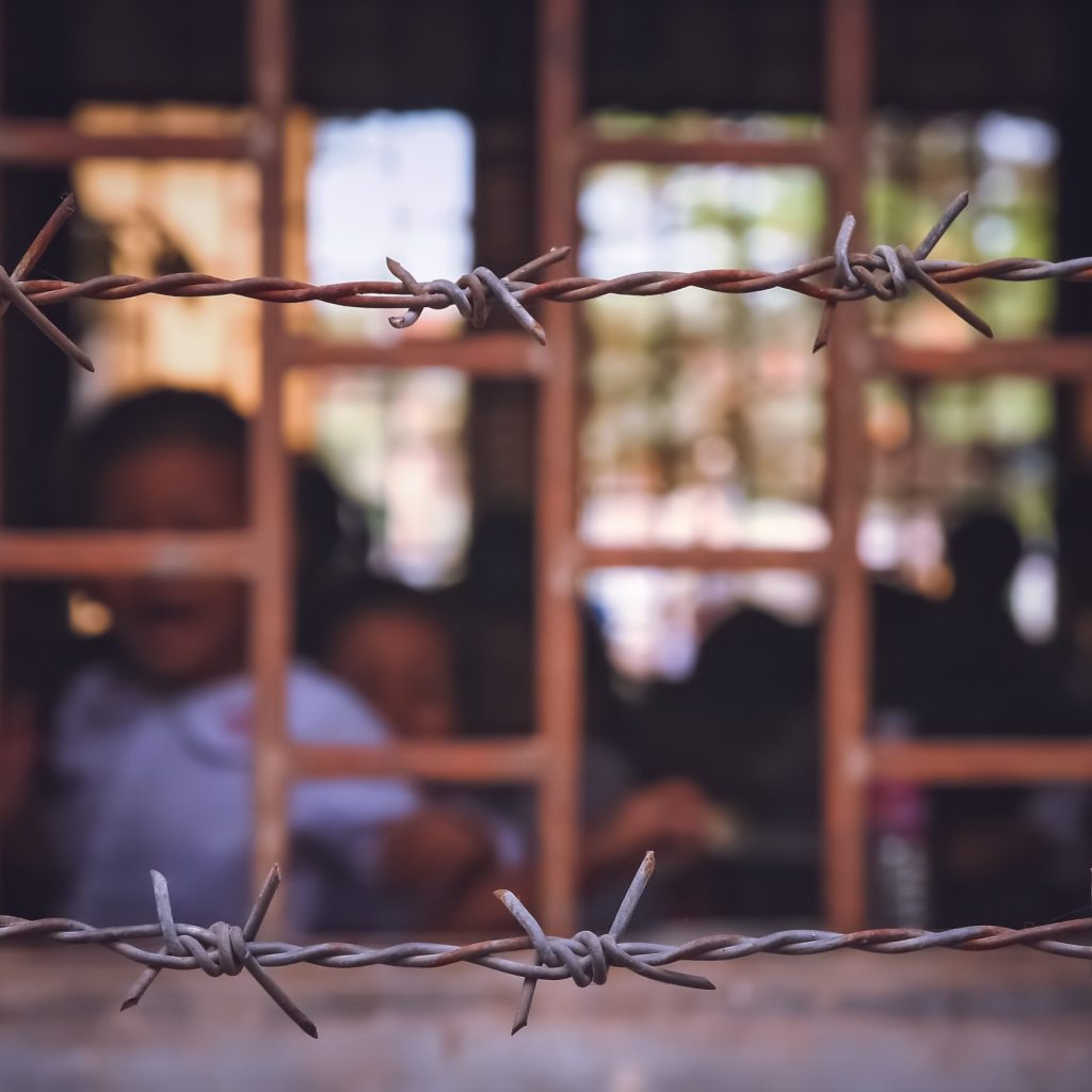 Barbed wire surrounding cambodian school based in the former prison, Phnom Penh, Cambodia