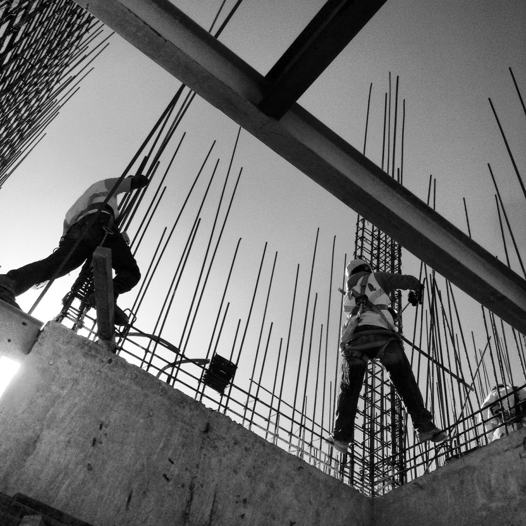 view-from-below-two-construction-workers-black-and-white_t20_k60XmR